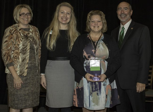 Lincoln County 4-H volunteer Yvette Chieves (second from right) accepts the Salute to Excellence Volunteer of the Year award from Wisconsin 4-H during a ceremony on Nov. 5 at Green Bay Conference Center. The award was presented by (from left to right) Wisconsin 4-H Assistant Program Director Kandi O'Neil, Wisconsin 4-H Leadership Council Member Stephany Beck and Wisconsin 4-H Program Director Dale Leidheiser.