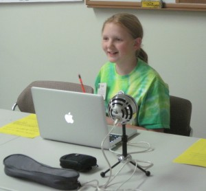 Grace working on her story during creative digital stories session.