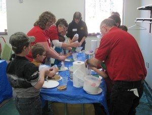 Norb and Barb Yogerst show participants how to make animal tracks during the wildlife session.