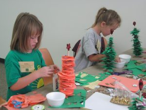 shelby-and-siobhan-creating-their-paper-christmas-tree