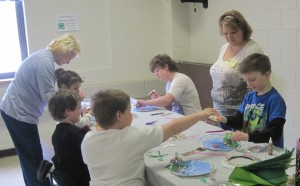 Yvette Chieves, 4-H volunteer leader, leads a session where youth created a Submarine Porthole Aquarium.