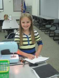 All smiles as this 4-H'er works on her project...