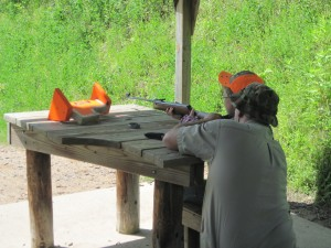 Blake receives instruction from John as he prepares to shoot at the target.
