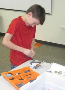 Caleb assembles his robot