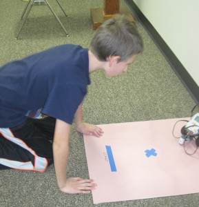 Ian works on programming his robot to complete a challenge exercise